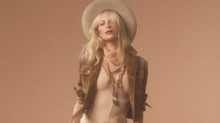 Poppy Delevingne poses in Bottega Veneta jacket and dress