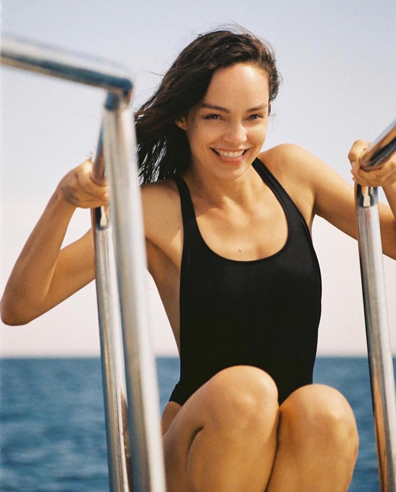 Flashing a smile, Luma Grothe models Solid & Striped The Robin one-piece swimsuit