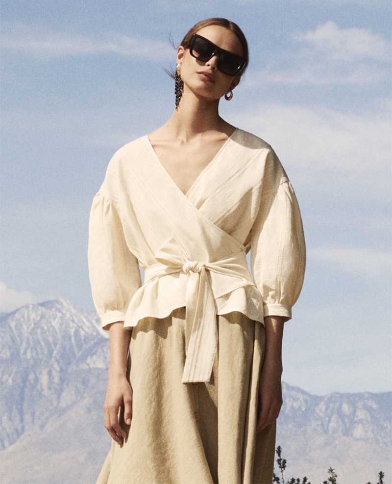 Birgit Kos wears Zara textured wrap top, buttoned linen skirt and square sunglasses