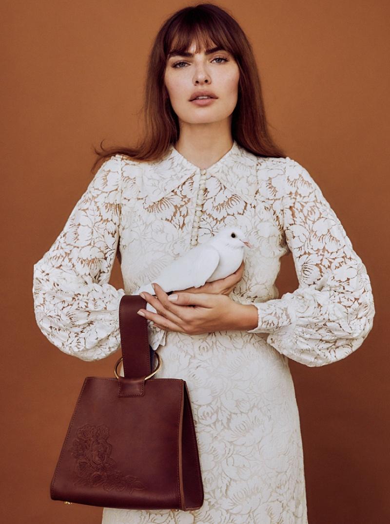 Alyssa Miller poses with brown bag in Pilgrim campaign