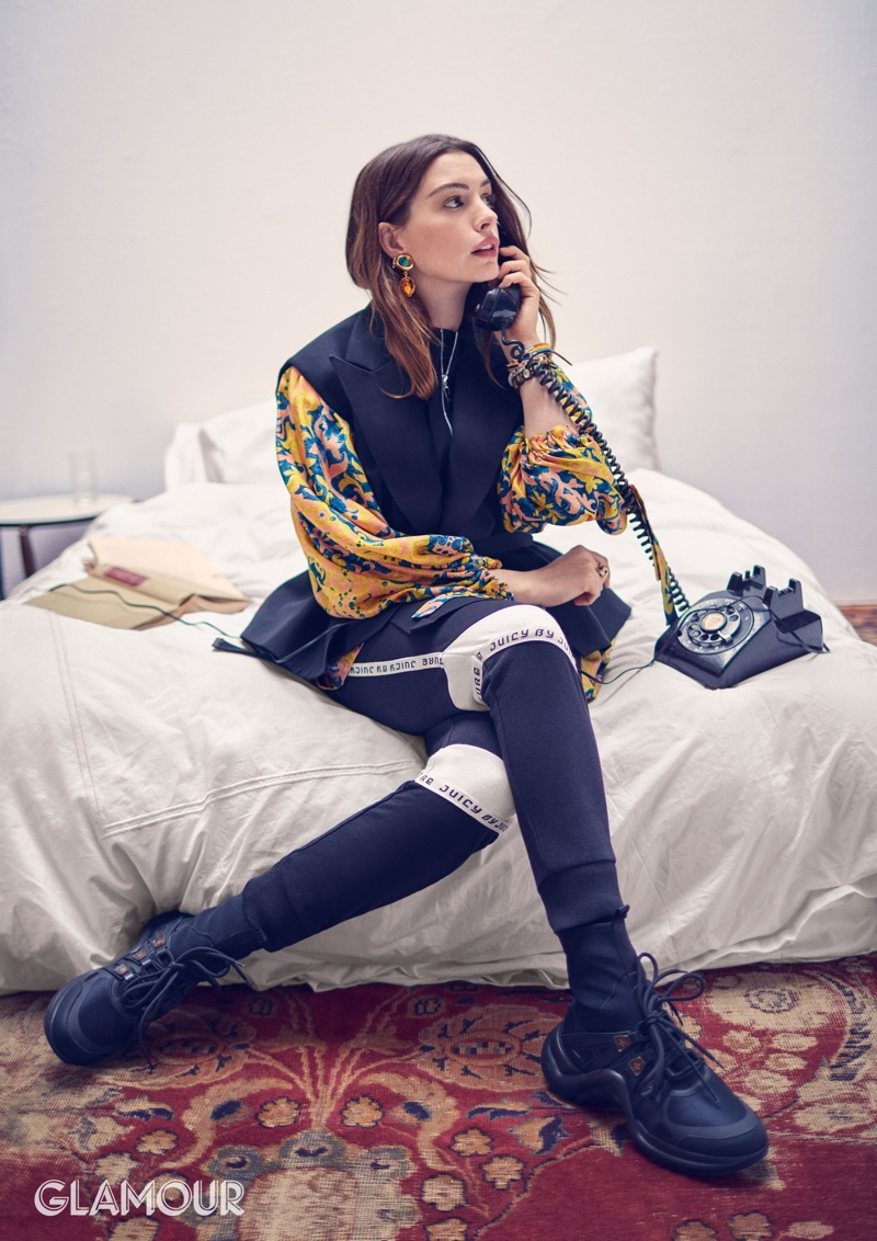 Anne Hathaway wears Louis Vuitton jacket, dress and shoes with Juicy by Juicy Couture pants