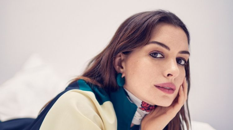 Actress Anne Hathaway poses in Lacoste dress, Rockins scarf and Celine earring