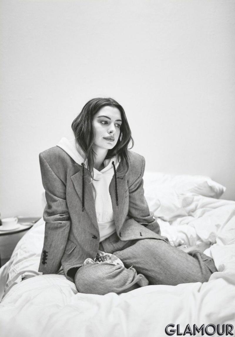 Anne Hathaway wears Eckhaus Latta blazer and pants with Ivy Park hoodie