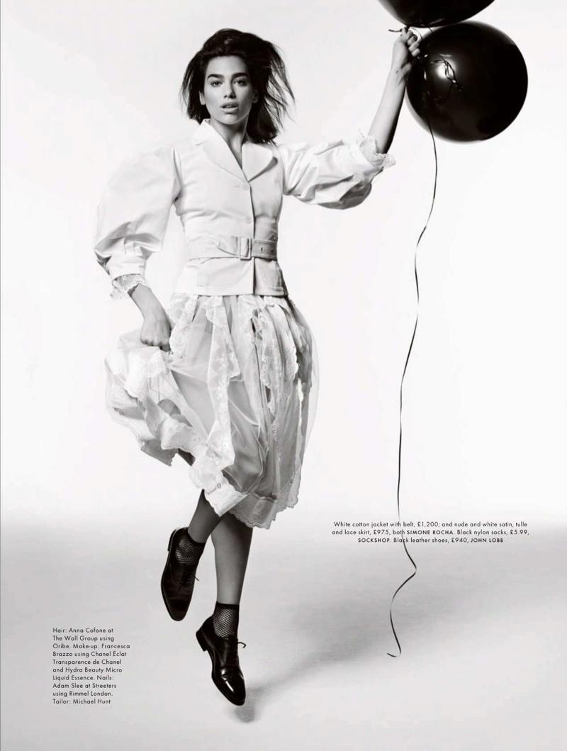 Dua Lipa wears Simone Rocha jacket and skirt with John Lobb leather shoes