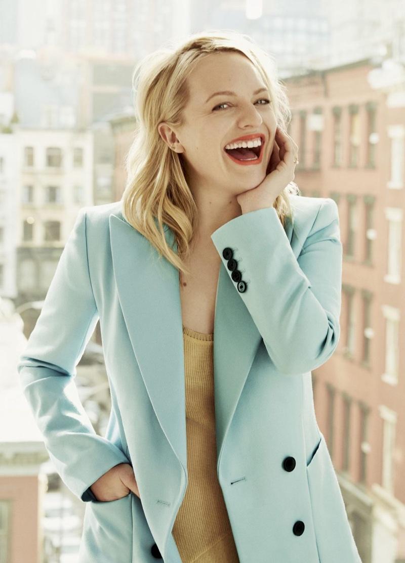 Flashing a smile, Elisabeth Moss poses in Bella Freud blazer and Stella McCartney dress
