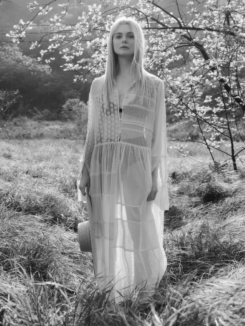 Elle Fanning wears white Joseph maxi dress