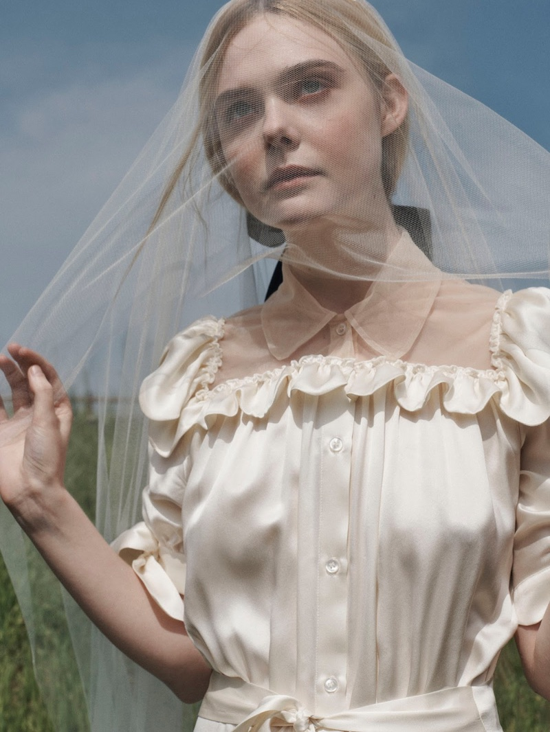 Covering up, Elle Fanning poses in Simone Rocha dress and Jennifer Behr hair clip