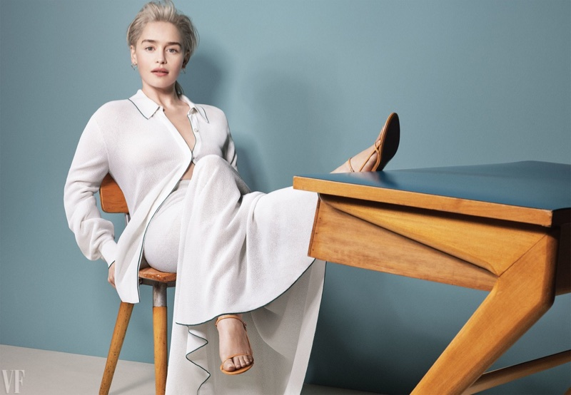 Kicking up her heels, Emilia Clarke wears Salvatore Ferragamo top and pants with The Row sandals
