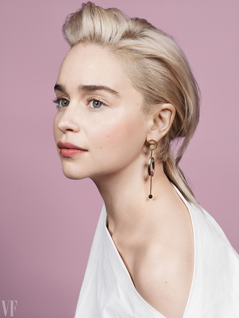 Showing off her blonde locks, Emilia Clarke wears The Row top and Yael Sonia earrings