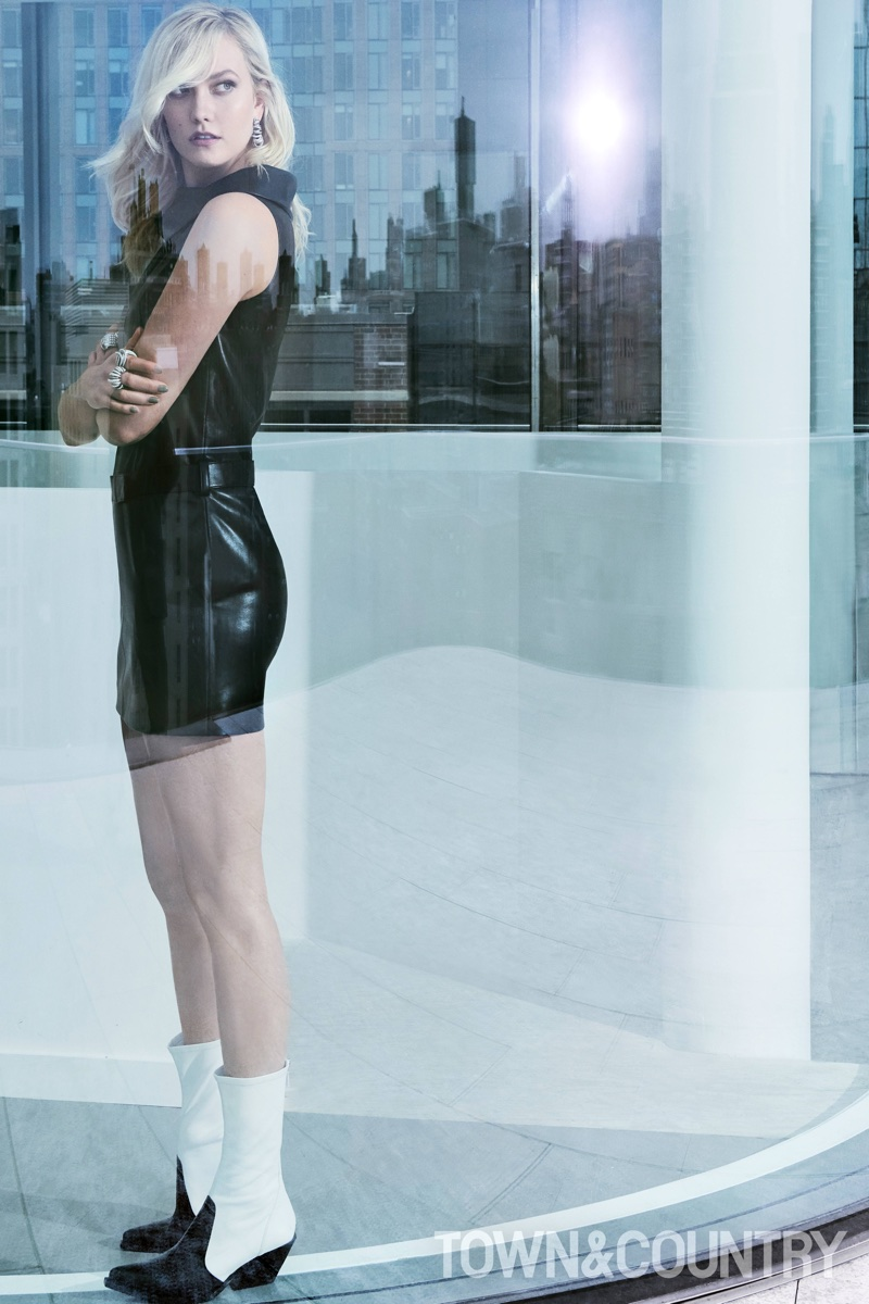 Model Karlie Kloss poses in Louis Vuitton dress and Givenchy boots