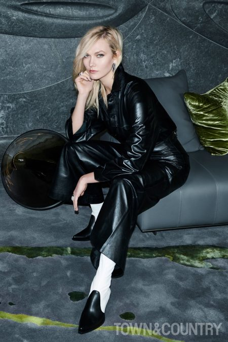 Karlie Kloss wears Celine jumpsuit and Givenchy boots