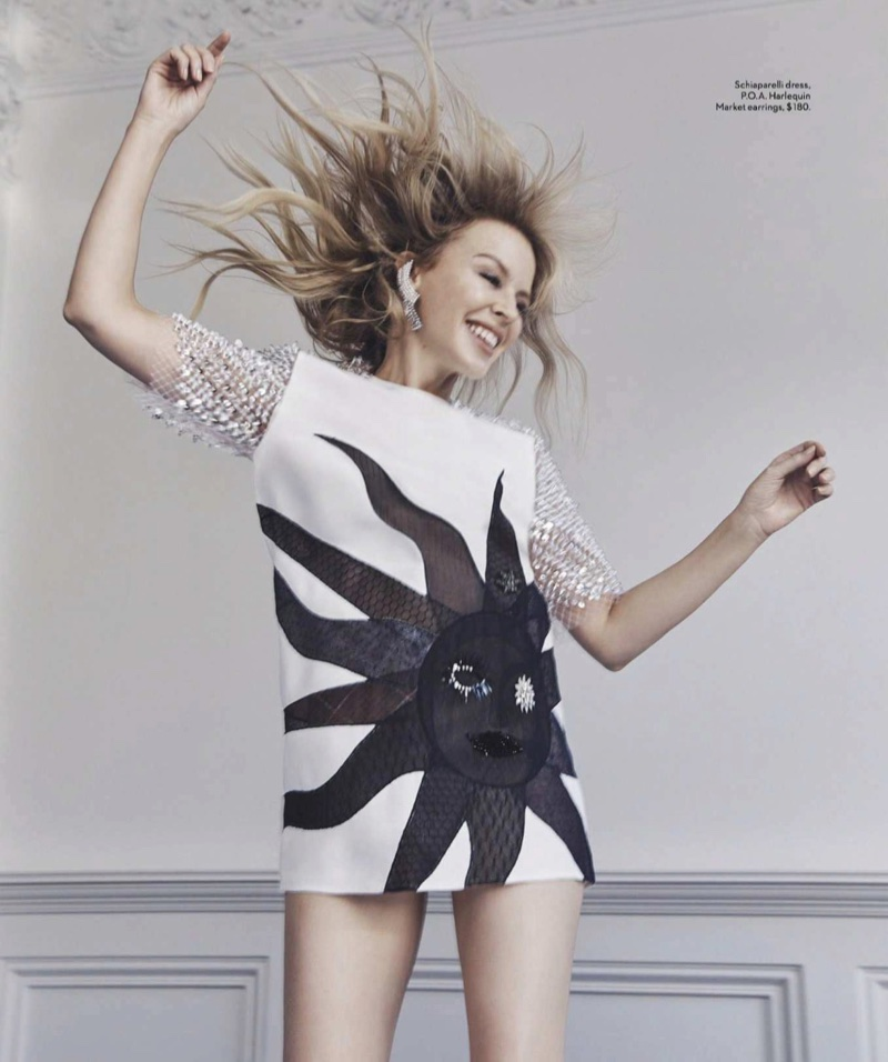 Kylie Minogue poses in Schiaparelli dress and Harlequin Market earrings