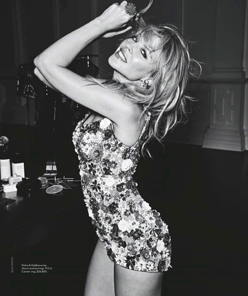 Photographed in black and white, Kylie Minogue wears Dolce & Gabbana top, shorts and earrings with Cartier ring