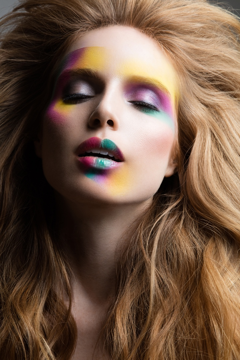 Wearing rainbow eyeshadow and lip color, Nell Rebowe poses for Jeff Tse.