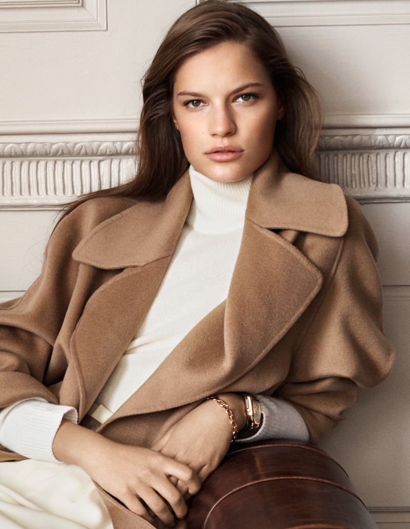 Faretta wears Ralph Lauren wrap coat from its Iconic Style collection
