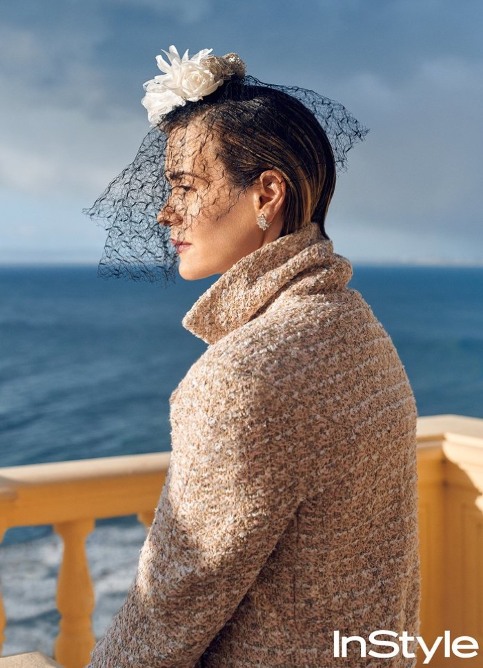 Actress Sarah Paulson wears Chanel Haute Couture coat and veil as well as Tiffany & Co. earrings