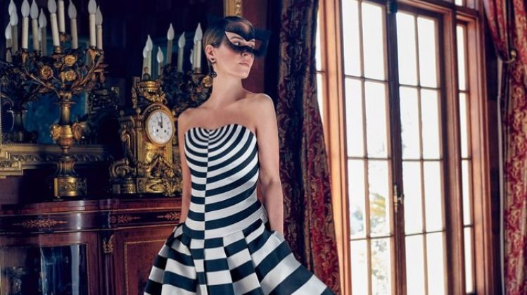 Sarah Paulson poses in striped Dior Haute Couture dress and mask