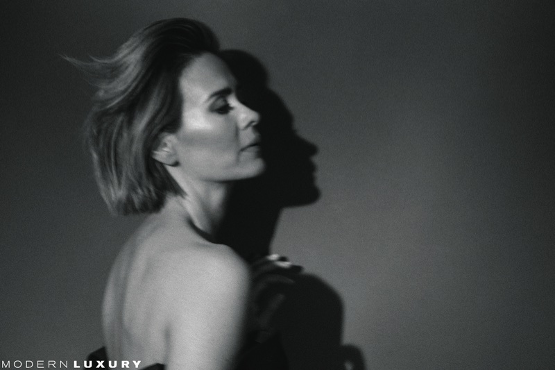 Photographed in black and white, Sarah Paulson wears Versace gown
