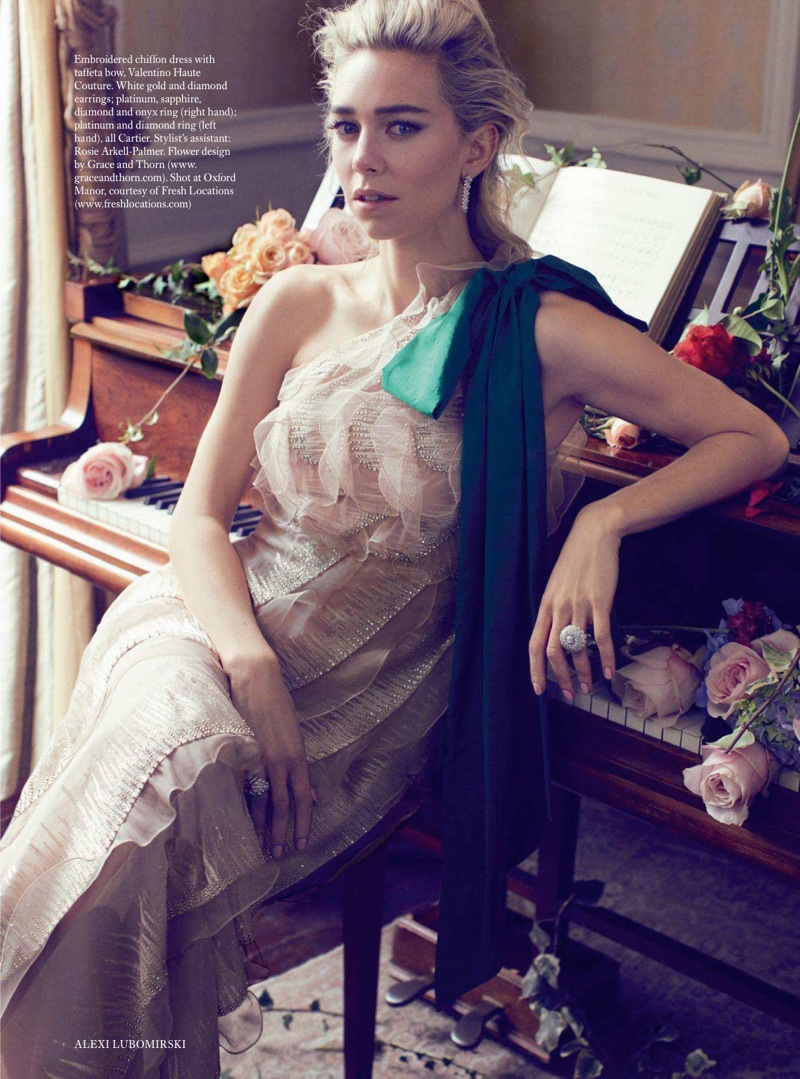 Vanessa Kirby poses in Valentino Haute Couture embroidered gown and Cartier jewelry