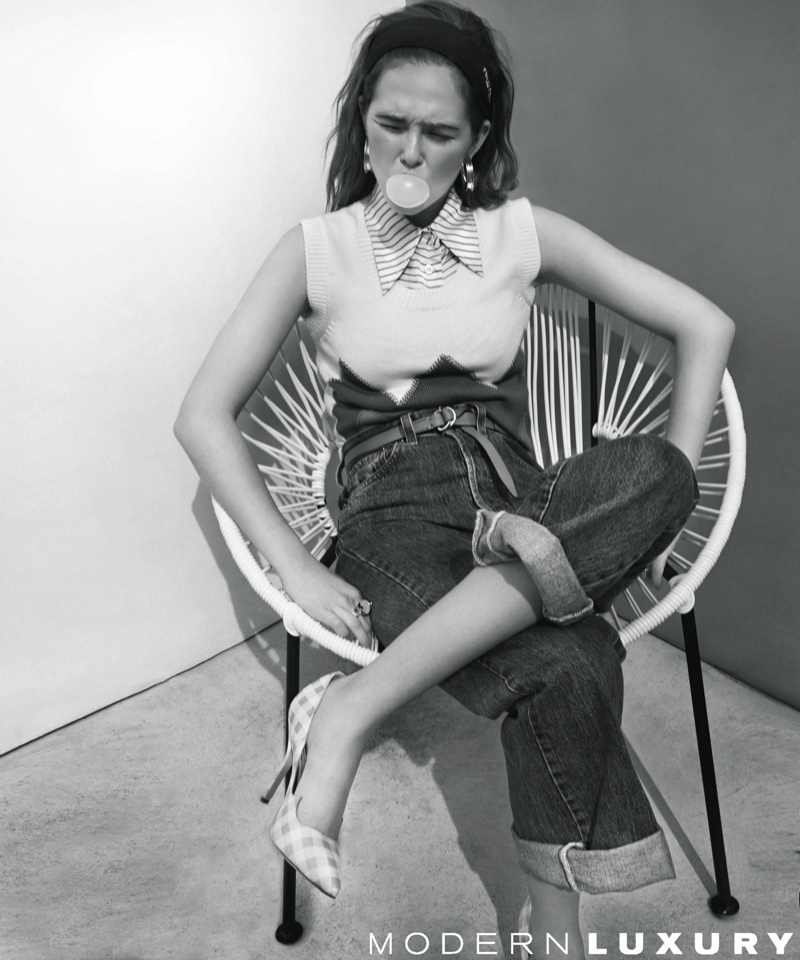 Photographed in black and white, Zoey Deutch poses in a chic outfit
