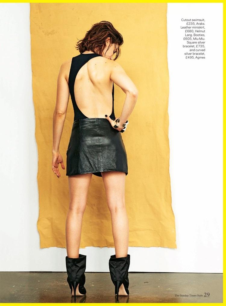 Alison Brie poses in Araks swimsuit, Helmut Lang miniskirt and Miu Miu booties