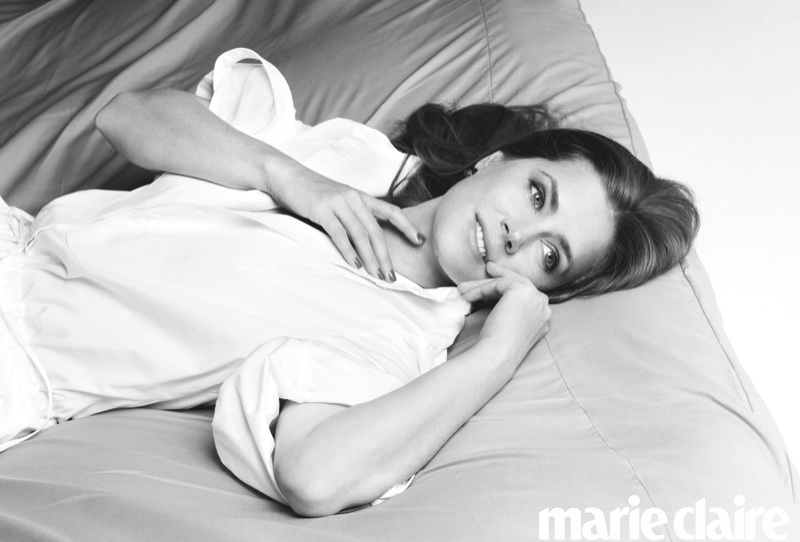 Photographed in black and white, Amy Adams poses in Oscar de la Renta jumpsuit