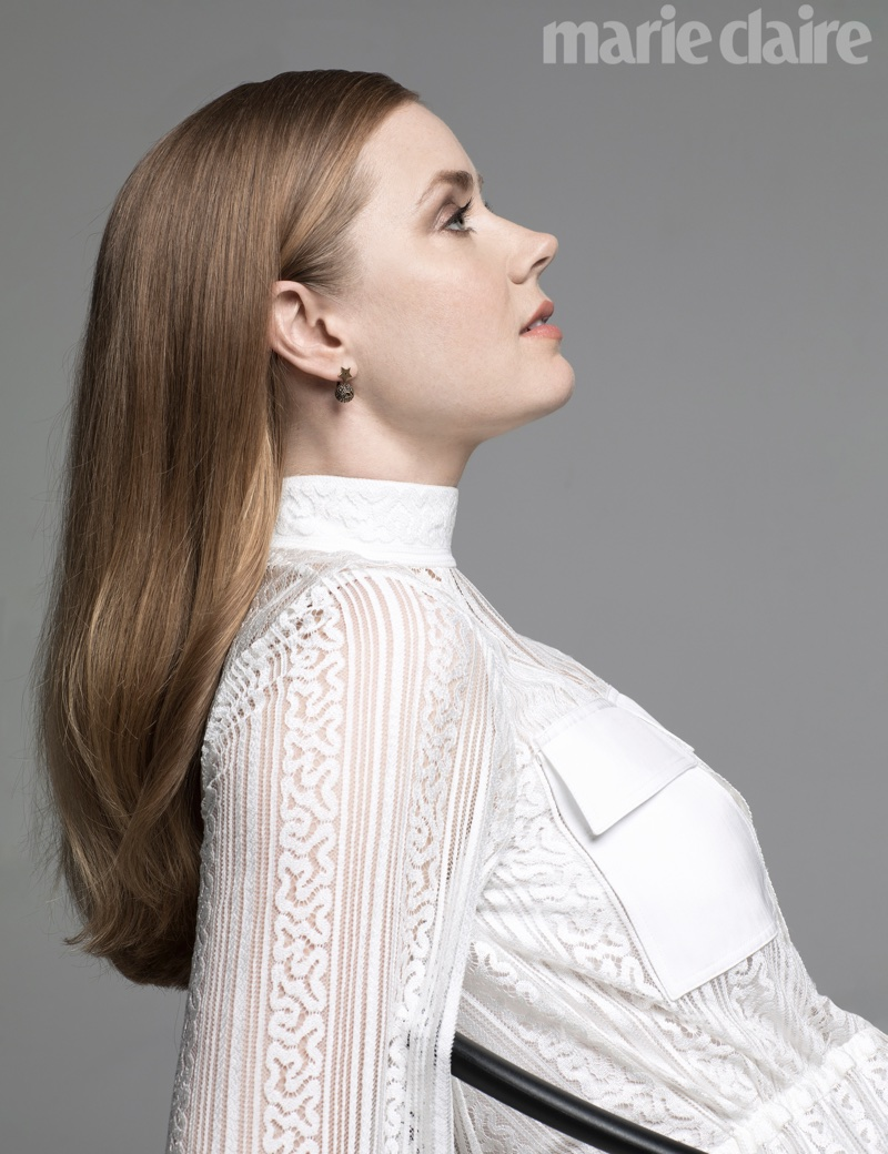 Amy Adams poses in white lace ensemble