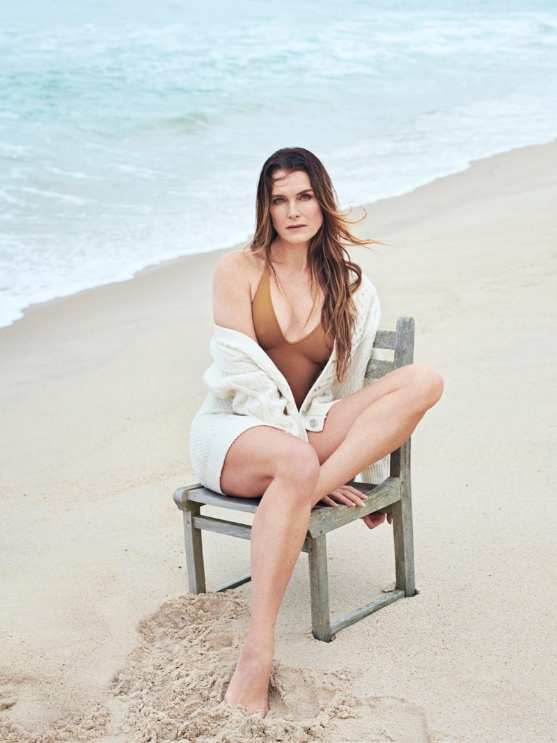 Posing at the beach, Brooke Shields models 3.1 Phillip Lim cardigan and Eres swimsuit