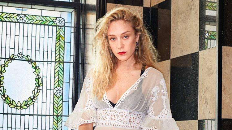 Chloe Sevigny poses in Dior dress and bra with Aron & Hirsch earrings and La Bouche Rogue rings