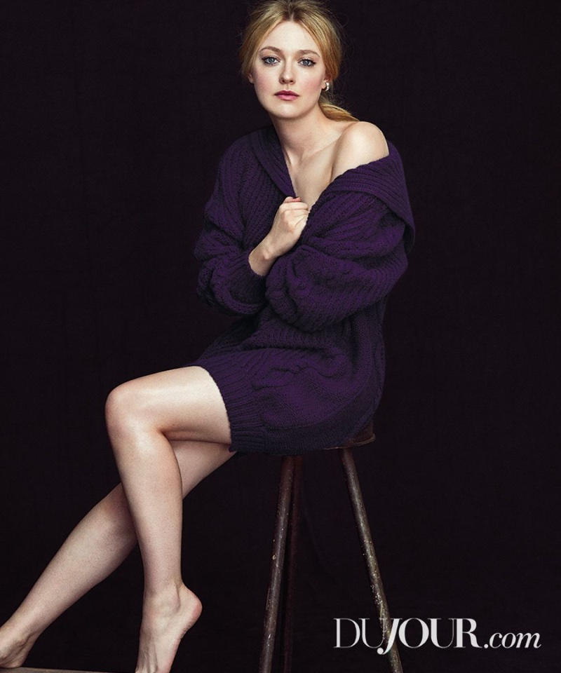 Actress Dakota Fanning wears Chanel cashmere and wool dress with Roberto Coin earrings