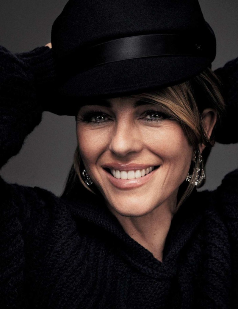 Flashing a smile, Elizabeth Hurley dresses in black