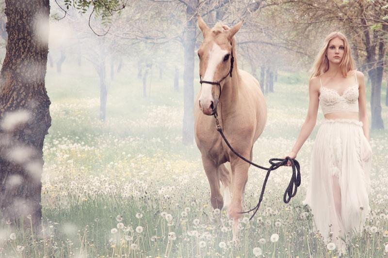 Kirin Dejonckheere poses with a horse in Ermanno Scervino's fall-winter 2018 campaign