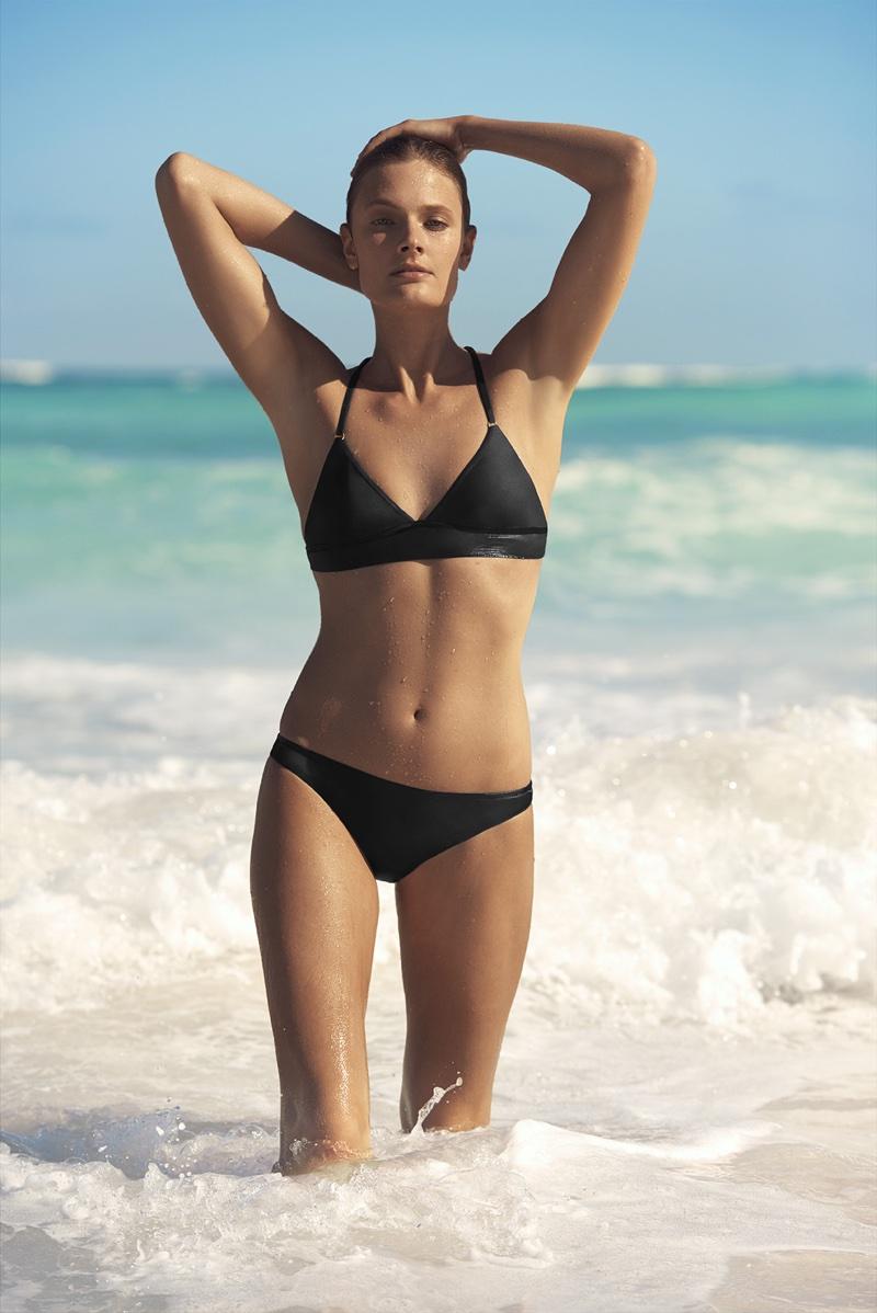 Constance Jablonski poses in black bikini for Etam Swim's summer 2018 campaign
