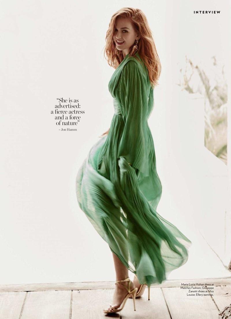 Dressed in green, Isla Fisher wears Maria Lucia Hohan dress and Giuseppe Zanotti heels