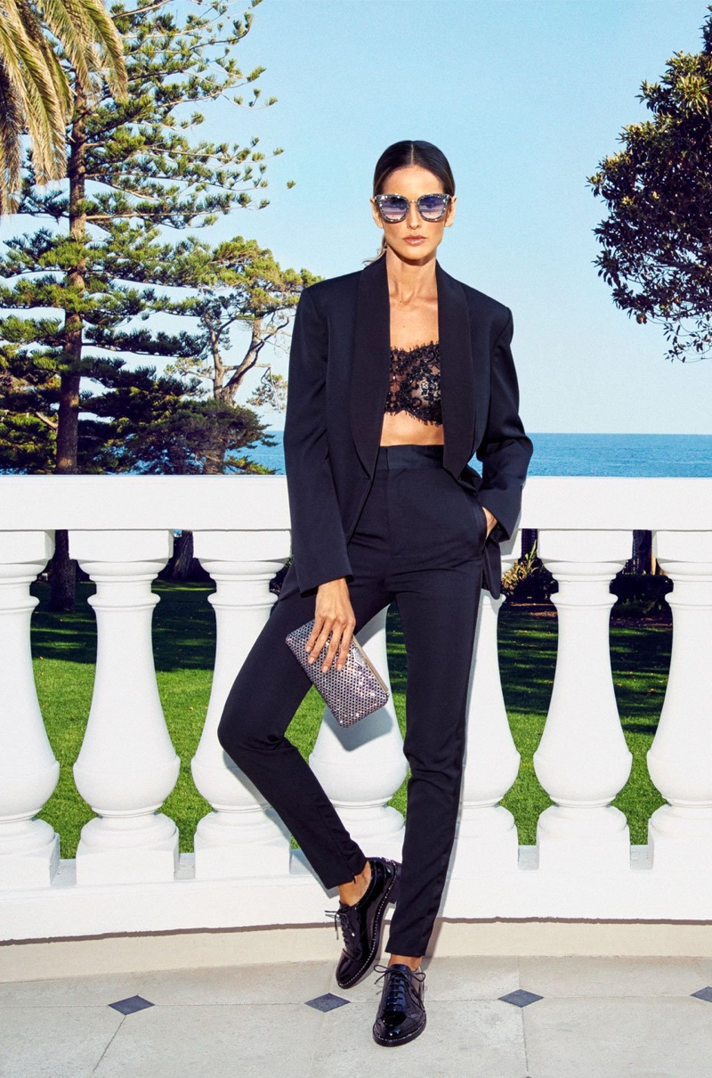 Izabel Goulart models Jimmy Choo Reeve Flat and Ellipse Clutch Bag