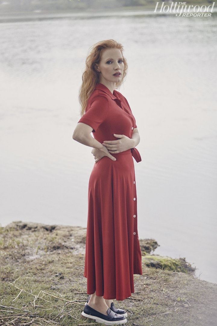 Posing in a red dress, Jessica Chastain is a striking vision