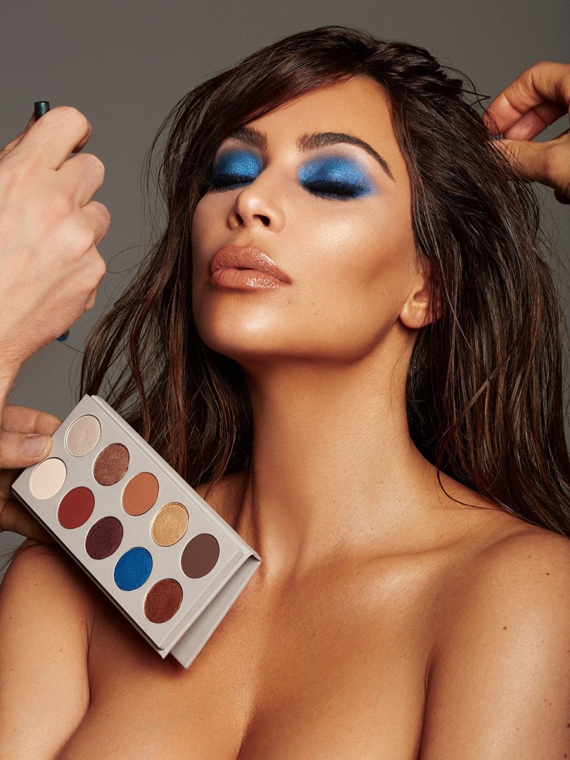 Wearing blue eyeshadow, Kim Kardashian appears in KKW Beauty x Mario campaign