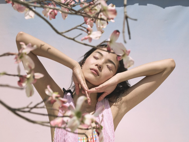 Xiao Wen Ju poses with cherry blossoms for La Ligne's summer 2018 campaign