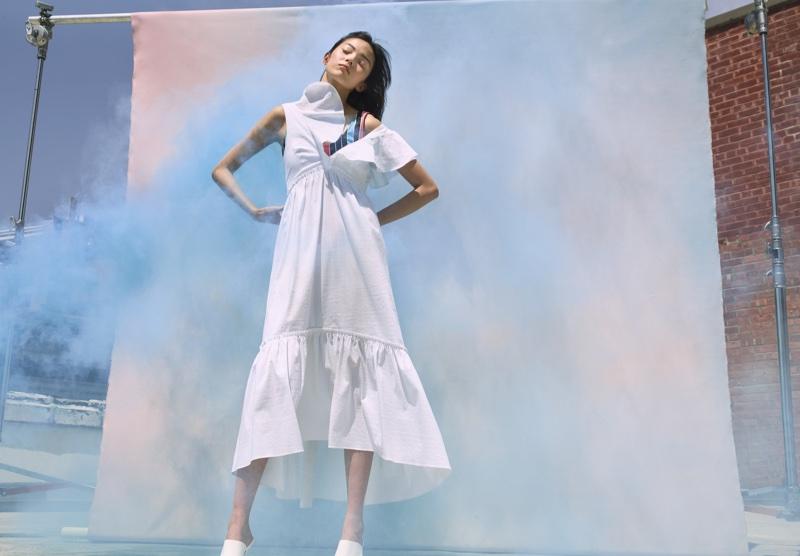 Xiao Wen Ju models white dress in La Ligne's summer 2018 campaign