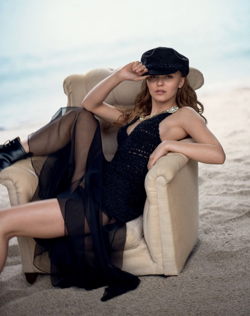 Posing on the beach, Lily-Rose Depp wears Chanel dress and hat