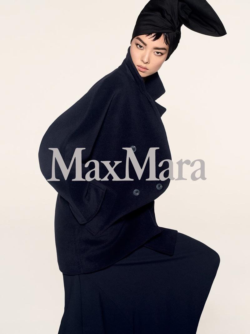 Fei Fei Sun wears a long coat in Max Mara's pre-fall 2018 campaign
