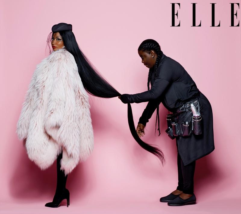 Rapper Nicki Minaj poses in Nini Ricci fur coat and veil hat with Stuart Weitzman pumps