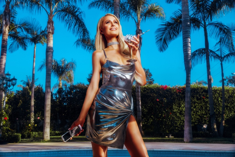 Paris Hilton wears silver dress from Bohoo collaboration