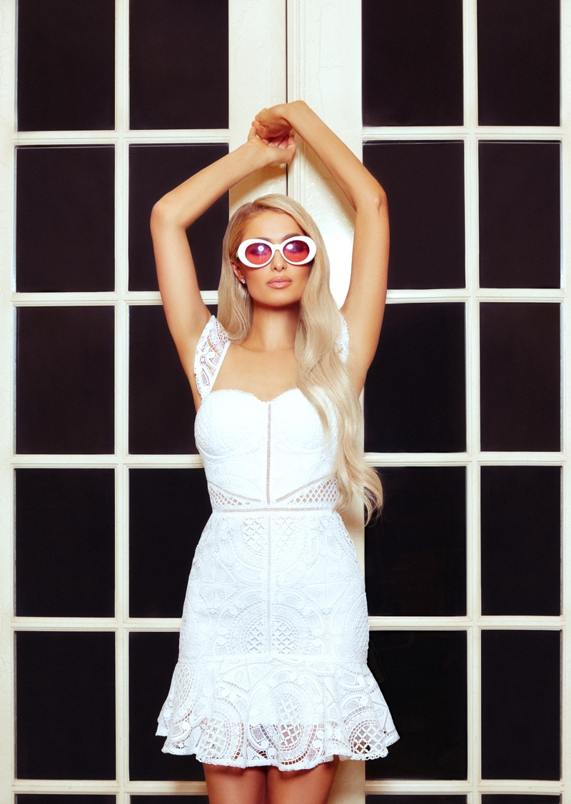 Paris Hilton wears white eyelet dress from Boohoo collaboration