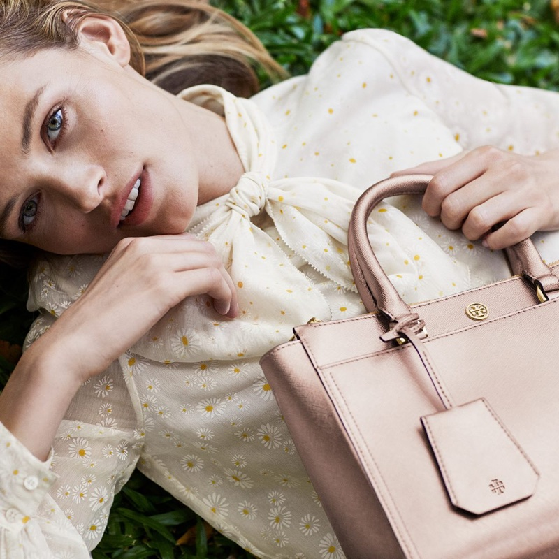 Model Edita Vilkeviciute poses with Robinson handbag in Tory Burch's pre-fall 2018 campaign
