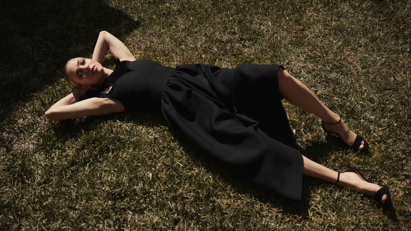 Laying on the grass, Amanda Seyfried wears Fendi dress and Jimmy Choo sandals