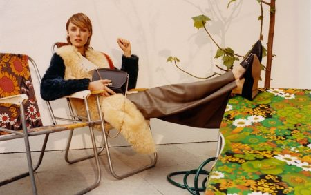 Edie Campbell poses in fur vest for Bally fall-winter 2018 campaign