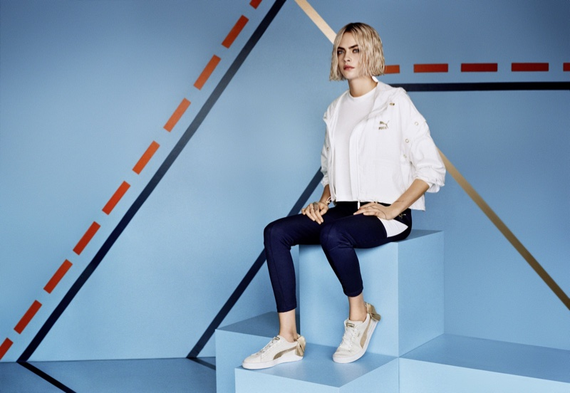 Cara Delevinge poses in new PUMA campaign wearing the Suede Bow Varsity sneaker