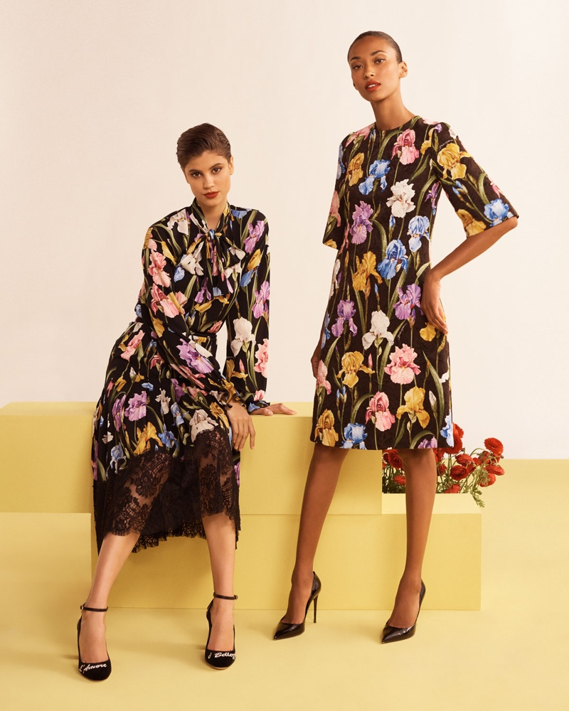 (Left) Dolce & Gabbana Long-Sleeve Tie-Neck Iris-Print Charmeuse Blouse and Floral-Print Silk Charmeuse Pleated Skirt with Lace Hem (Right) Dolce & Gabbana Elbow Sleeve Iris-Print A-Line Brocade Dress