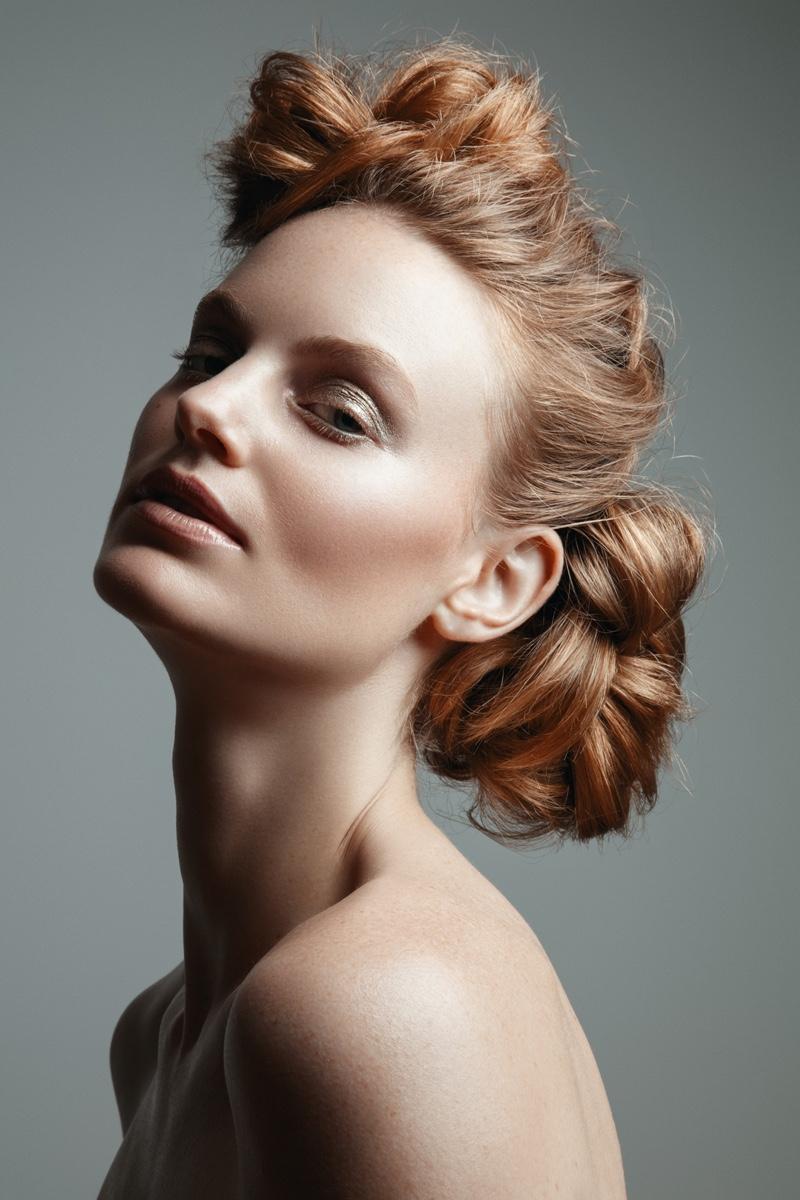 Model Georgie Wass wears a polished updo hairstyle. Photo: Jeff Tse